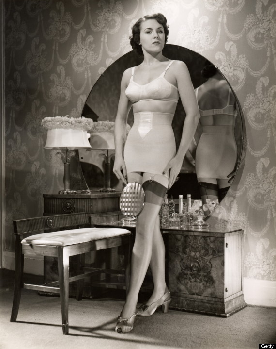 Woman in brassiere and girdle